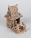 Image of Clay model of a house with people and a dog